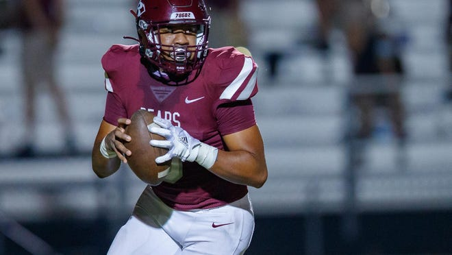 Bastrop quarterback Romello Flores-Giles runs a keeper during the Bears' loss Friday to Rudder.