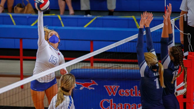 Westlake's Katie Hashman, left, had 13 kills in the Chaps' win over then-No. 1 Austin High last week to earn American-Statesman player of the week honors.