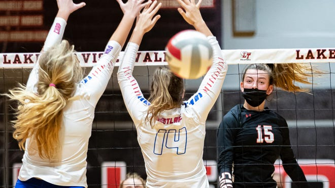 Lake Travis outside hitter Jamison Wheeler watches her shot get through Westlake's blockers during a District 26-6A contest Tuesday at Lake Travis High School. Wheeler had 20 kills as the Cavs rolled to a three-set win in a battle between the top two teams in the Statesman's Class 6A poll.