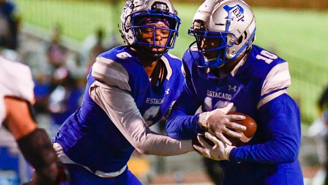 Estacado's Jay'Lon Dobbins (6) hands the ball off to TJ Steele (10) against Seminole during a District 2-4A Division II game Oct. 9 at PlainsCapital Park at Lowery Field.