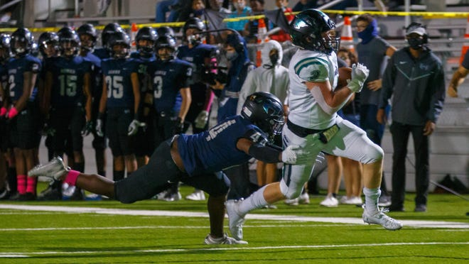 Cedar Park quarterback Ryder Hernandez leaps over the goal line for the touchdown against the Hendrickson Hawks on Thursday at The Pfield in Pflugerville. Cedar Park raced to a 66-28 win in the District 11-5A Division I contest.