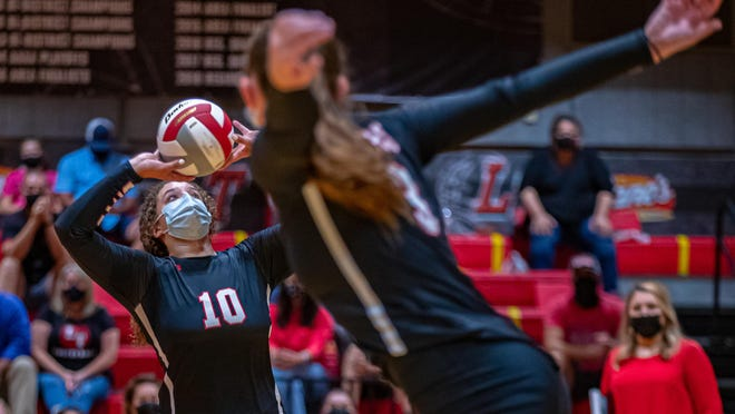 Lake Travis' Kiana Reed, left, took over full-time setting duties after the Cavs switched to a 5-1 rotation in the offseason. Reed ranks second in the state with 11.2 assists per set for undefeated Lake Travis.