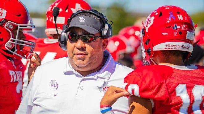 Travis head coach Joe Frank Martinez led the Rebels to a 42-6 win over Navarro Friday.