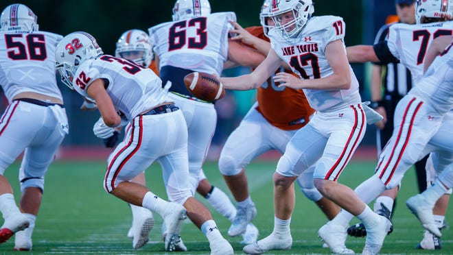 Lake Travis quarterback Bo Edmundson, faking a handoff to Weston Stephens against Westwood earlier in the season, completed 24 of 31 passes for 357 yards and five touchdowns Friday in a 62-20 victory over Austin High to earn American-Statesman player of the week honors.