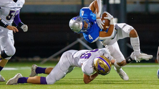 McCallum running back Andres Rodriguez is toppled by Marble Falls defensive back Ryan Minor during McCallum's 14-0 win Thursday at House Park.