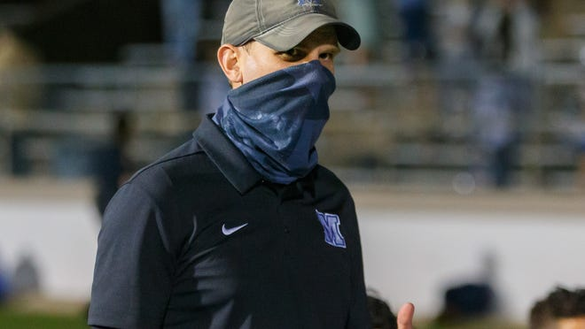 McCallum head coach Thomas Gammerdinger led the Knights to a 20-0 win over Northeast Friday at Nelson Field.