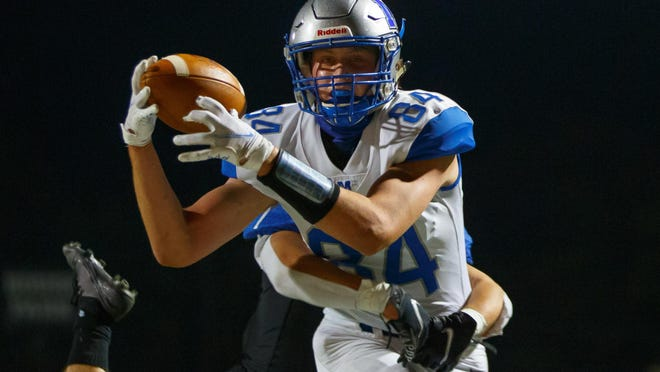McCallum tight end JD Jordan, catching a touchdown pass during the Knights' game against Anderson, didn't start playing football until his freshman year.