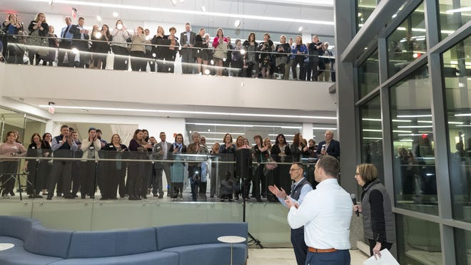 CC5 employees join CEO Dorothy Savarese, Bert Talerman (left) and Matt Burke, co-presidents, for a company-wide grand opening party at the bank's new Hyannis headquarters earlier this year.
