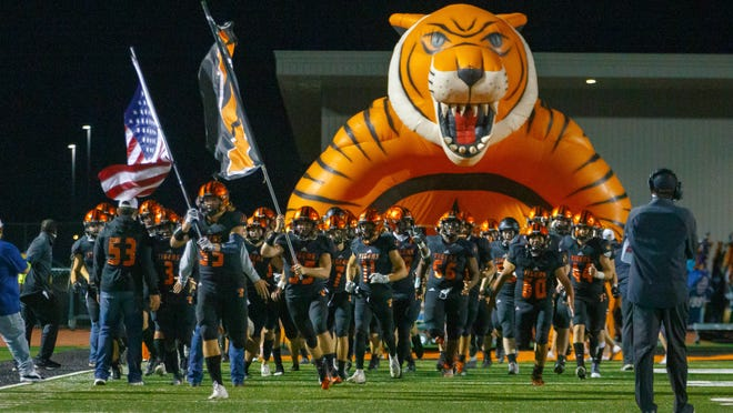 Smithville, TX; Smithville Tigers return to the field to begin the second half against the Wimberley Texans at the bidistrict Class 4A-2 football playoff game on Friday, Nov 13, 2020, at Smithville High School.