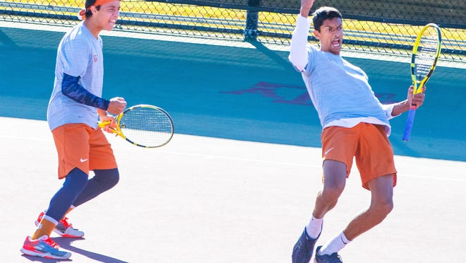 Westwood's Zeyad Elchouem, left, and Sachchit Sivaram celebrate a point against Plano West during their boys doubles match as Westwood won the Class 6A state title Tuesday. [JOHN GUTIERREZ FOR STATESMAN]]