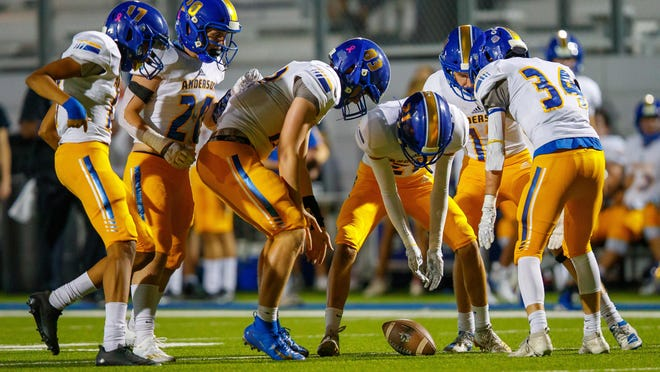 Anderson' football team, converging in punt coverage earlier this season against Pflugerville, will go into quarantine until the end of the month after a positive coronavirus test. The Trojans' quarantine triggered a schedule reshuffle for other teams in District 11-5A DI.
