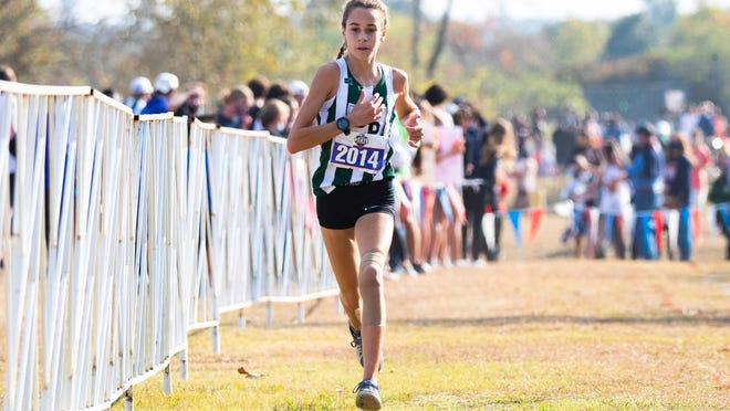 Cedar Park's Isabel Conde De Frankenberg drives toward the finish line as she wins the girls Class 5A UIL State Cross Country race Monday at Old Settler's Park in Round Rock.