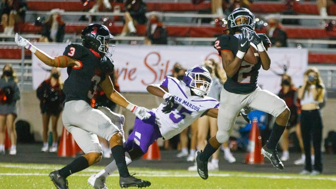 Bowie Bulldogs wide receiver/safety Jason Gaines, intercepting a pass during a victory over San Marcos, came up big on offense, defense and special teams in the district victory Thursday at Burger Stadium.