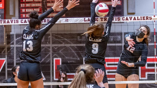 Lake Travis outside hitter Arden Besecker fires the ball through the block of San Antonio Clark's Kendall Harrington during Lake Travis' area round win in the Class 6A playoffs Monday at Lake Travis High School. Besecker finished with 10 kills in the 25-11, 25-19, 25-17 sweep.
