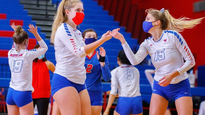 Westlake's Genevieve Perry, left, and Katie Hashman get set for the opening serve of a match against Cedar Ridge earlier in the season. The Chaparrals bowed out of the volleyball playoffs Tuesday with a loss to San Antonio Brandeis.