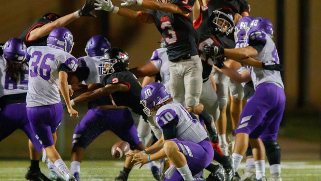 Bowie senior Jason Gaines, blocking this field goal attempt against San Marcos last week, has been solid for the Bulldogs on offense, defense and special teams. He was the Central Texas player of the week following this victory over the Rattlers.