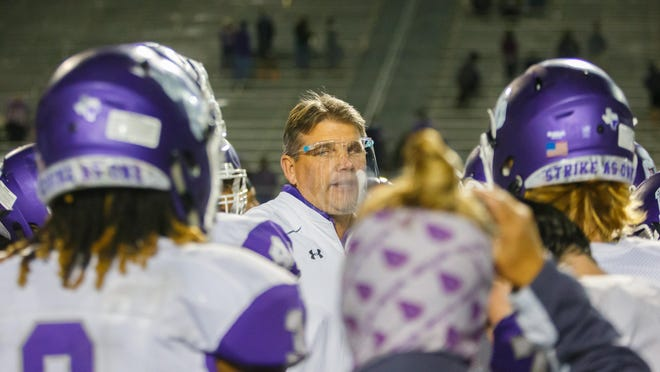 San Marcos head coach John Walsh led the Rattlers to a 21-0 win over Akins Friday.