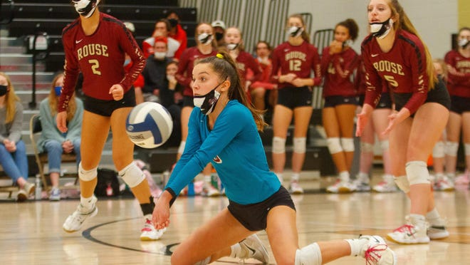 Rouse libero Megan Schulz digs the ball from her knees against New Braunfels Canyon during the first set at the Class 5A regional quarterfinals volleyball playoff Saturday at Johnson High School. Canyon won 3-0 to advance to the regional tournament.