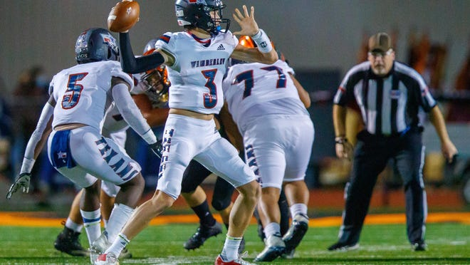 Wimberley quarterback Matthew Tippie, passing during an earlier playoff game against Smithville, fired a pair of late touchdown passes to help the Texans defeat Sinton in a Class 4A playoff game last week.