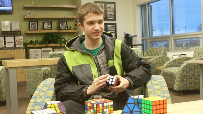West High freshman Cale Schoon holds the record in North America for solving this type of cube — each side has five colored squares — in the fastest time without looking