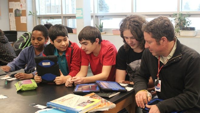 From left to right: Sean Reasnover, 13, Brandon Reyes, 12 Matt Rew, 13, Demetrious Ramirez, 13 and teacher Ben Mosher worked on Genius Hour projects at South East Junior High on Jan. 26, 2015.