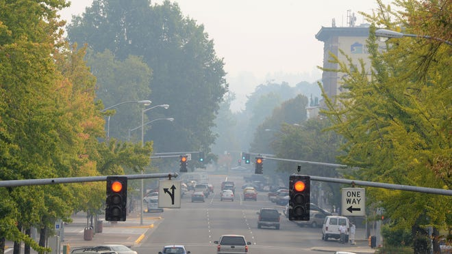Smoke is visible looking south on High Street in downtown Salem on Monday, Sept. 15, 2014.
