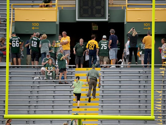 Fans file out of the stadium bowl after storms disrupted