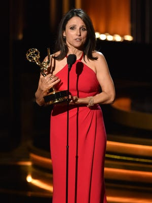 """Actress Julia Louis-Dreyfus accepts outstanding lead actress in a comedy series for """"Veep"""" onstage at the 66th Annual Primetime Emmy Awards on Monday in Los Angeles."""