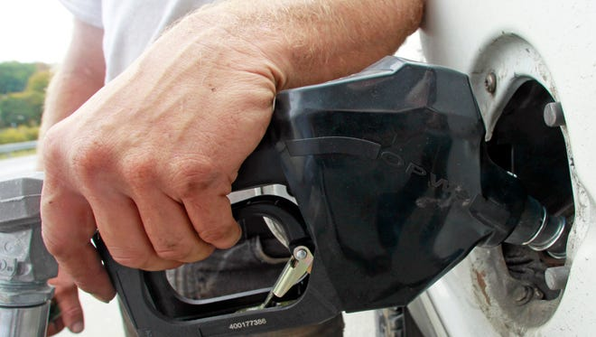 A customer fills up at a gas pump on Sept. 27, 2013, in Montpelier, Vt.