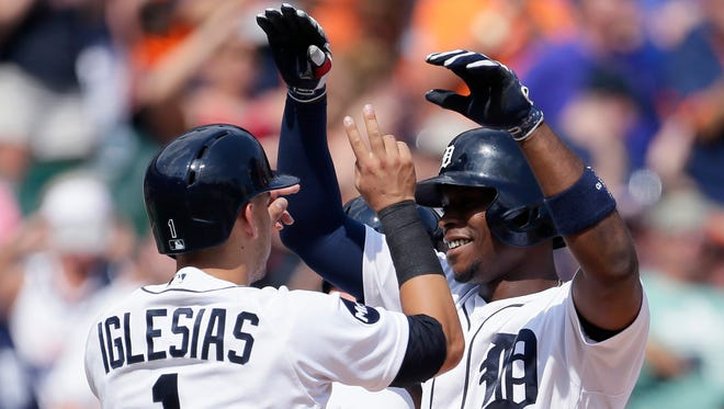 Tigers leftfielder Justin Upton celebrates with shortstop Jose Iglesias after hitting a grand slam during the seventh inning of the Tigers' 13-1 win over the Astros on Sunday, July 30, 2017, at Comerica Park.