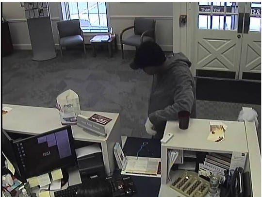 A surveillance photo shows a bank robbery suspect at