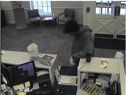 A surveillance photo shows a bank robbery suspect at a BB&T office in West Deptford Monday.