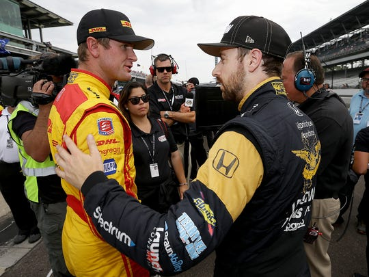 Andretti Autosport IndyCar driver Ryan Hunter-Reay (28) and Schmidt Peterson Motorsports IndyCar driver James Hinchcliffe (5) following their qualifying run for the Indianapolis 500 Friday, May 20, 2017, afternoon at the Indianapolis Motor Speedway.