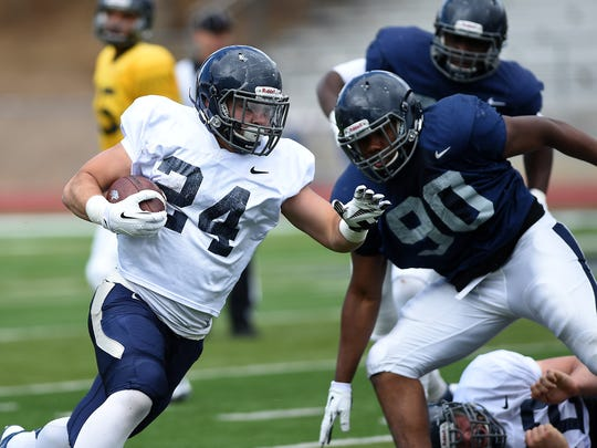 Nevada's Lucas Weber, shown running the ball in the 2015 spring game, came to the Wolf Pack from McQueen as a running back.