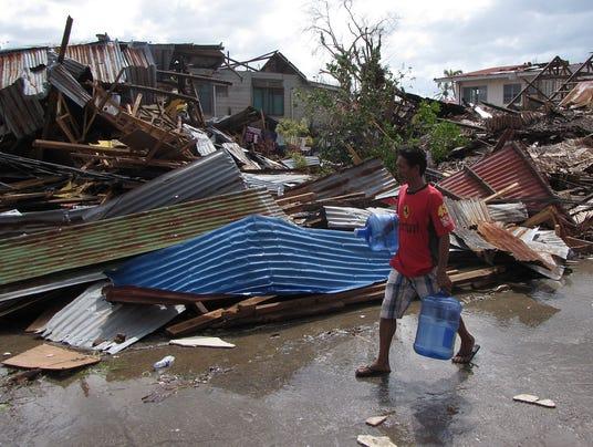 relief effort intensifies after philippines tragedy. Black Bedroom Furniture Sets. Home Design Ideas