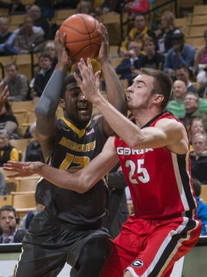 Namon Wright collides with Georgia's Kenny Paul Geno as they fight for a rebound Wednesday.