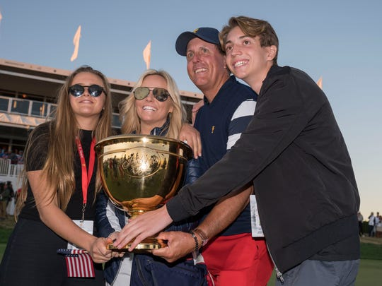 Phil Mickelson poses with his family and the Presidents Cup trophy after the final round of The Presidents Cup golf tournament on Oct. 1, 2017.