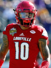 Louisville Cardinals cornerback Jaire Alexander (10) against the LSU Tigers prior to the game at Camping World Stadium.