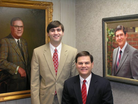 John Albriton, seated, and his son, Cameron, are third and fourth generation Albriton jewelers.