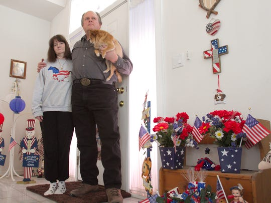 Terry Adams and his wife Linden are staunch supporters of America, as is evidenced anywhere in or around their Brighton Township home. Terry holds their Chihuahua/pomeranian mix named Bonnie.