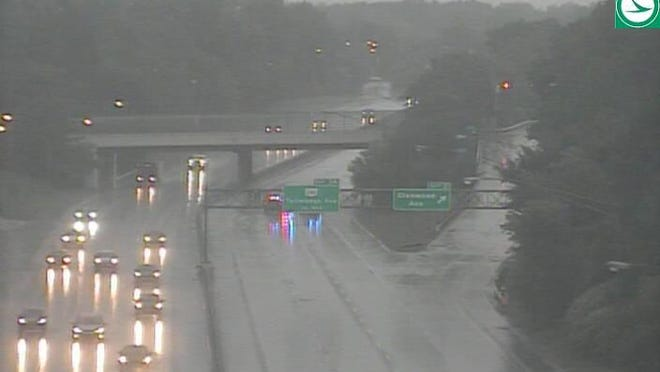 Akron police officers make drivers exit state Route 8 north at Perkins Street because of flooding Monday, Sept. 7, 2020, in Akron, Ohio.