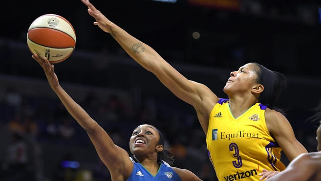 Minnesota Lynx guard Renee Montgomery, left, shoots as Los Angeles Sparks forward Candace Parker defends during the first half in Game 4 of the WNBA Finals on Sunday, Oct. 16, 2016, in Los Angeles.