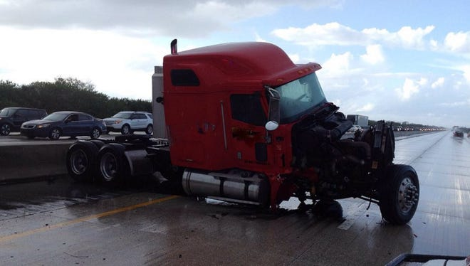 A semi-trailer that crashed into a barrier on Saturday, Nov. 7, 2015 on Interstate 95.
