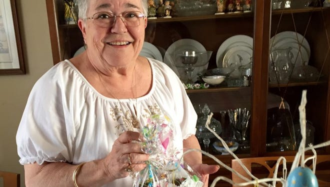 Brenda Gentry at Easter last year holding the chocolate-covered eggs given to her by a reader.