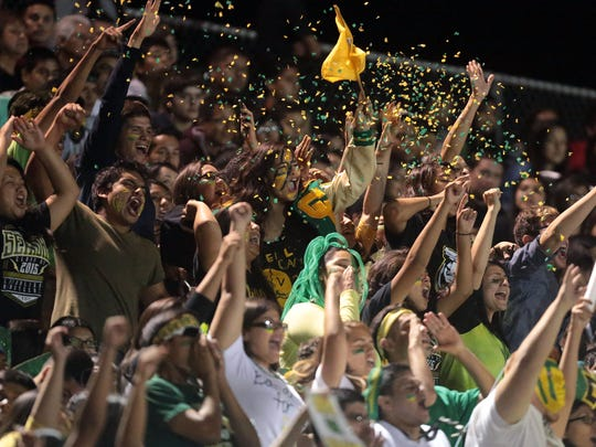 Coachella Valley fans celebrate a touchdown against Indio, during the annual battle for the Bell rivalry game in 2014.