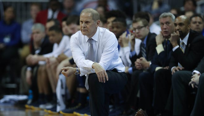 John Beilein on the bench during Michigan's 69-68 loss to Oregon in the NCAA tournament Thursday, March 23, 2017 at the Sprint Center in Kansas City.