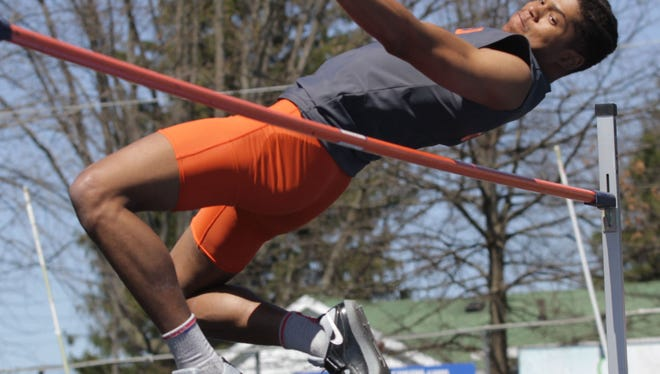 Mansfield Senior's Joe Ellis clears a meet record and personal best 6 feet-10 inches to win the high jump at Saturday's Lexington Invitational.