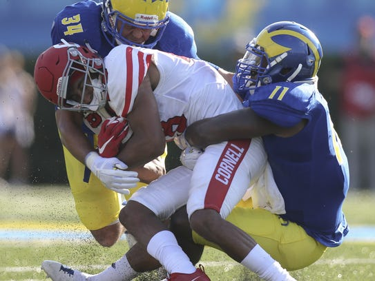 Cornell wide receiver James Hubbard is tackled after