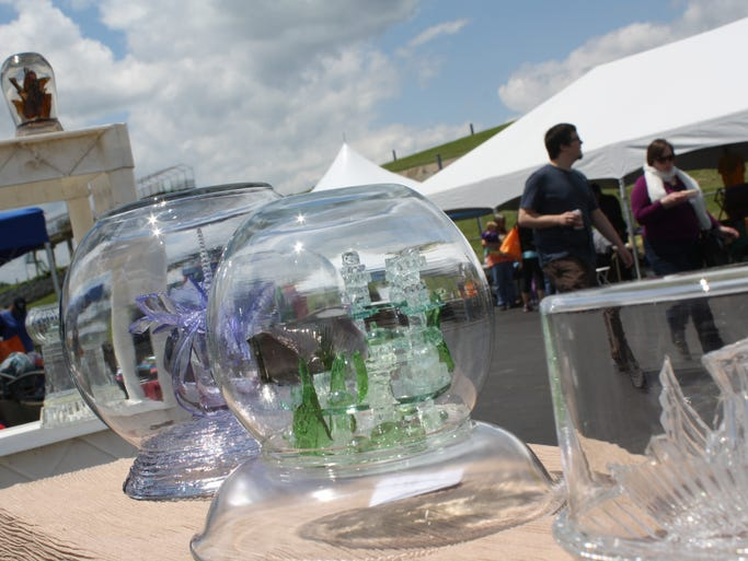 Artwork created from broken glass fill the booth of Urban Art Glass during the second annual Save Our Earth festival hosted by Trash Force, Inc. on the New Albany waterfront on Saturday.  (By Jenna Esarey, special to The Courier-Journal)  May 17, 2014.