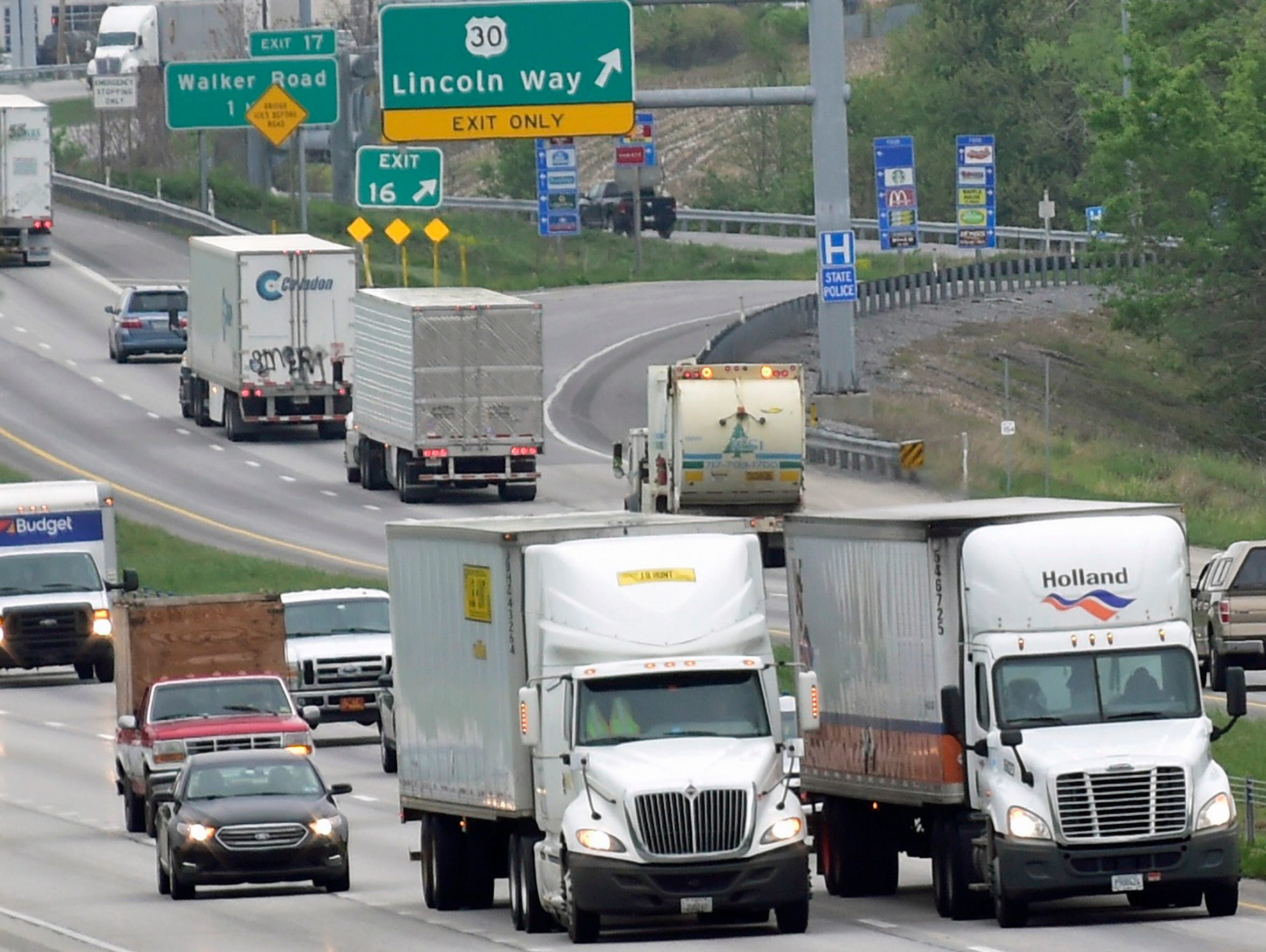 Tractor-trailers compete with passenger cars Thursday, May 5, 2016 on a stretch of Interstate 81 near Exit 16. Exit ramps and on-ramps have been connected in this area, between Wayne Avenue (Exit 14) and Walker Road (Exit 17), creating a third lane and helping to ease congestion.